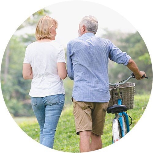 elderly man walking with his daughter and offering financial advice